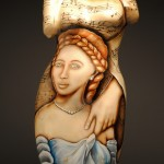 female sculpture-china painted with sensually dressed woman and sheet music